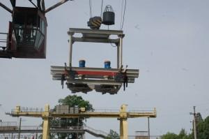 Устройство для разравнивания насыпных грузов в полувагонах